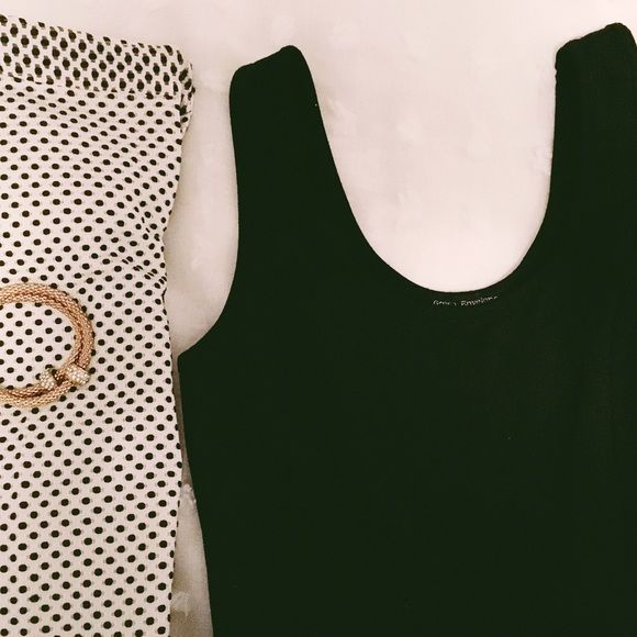 Peplum Black Top great condition no discoloration  the label is faded, can't really see what type of material it is made from. Green Envelope los angeles Tops Blouses