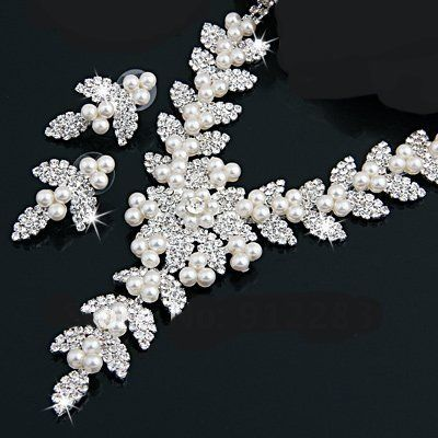 Silver Plated Crystal Rhinestone and White Faux Pearl Bridal Necklace and Matching Earrings Set PJ Designs,http://www.amazon.com/dp/B00F4Q3B92/ref=cm_sw_r_pi_dp_kW03sb0QX0C060CG