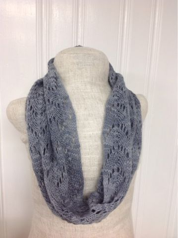 This soft, fluffy, single plied yarn creates a delightful lacy cowl. The lacy texture is perfect for spring, with a soft neutral color to ma...