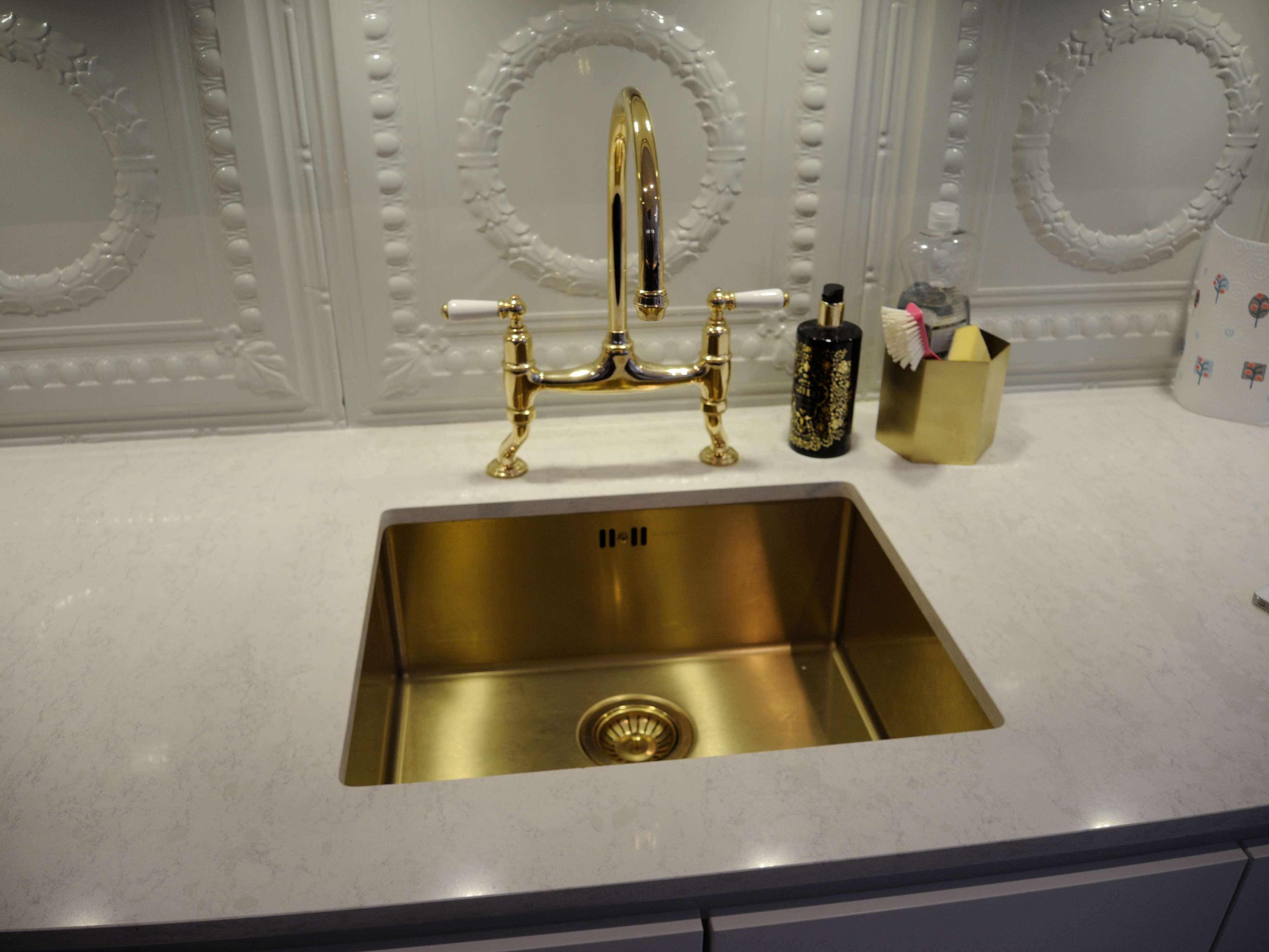 An under mounted Alveus Monarch Gold kitchen sink in a