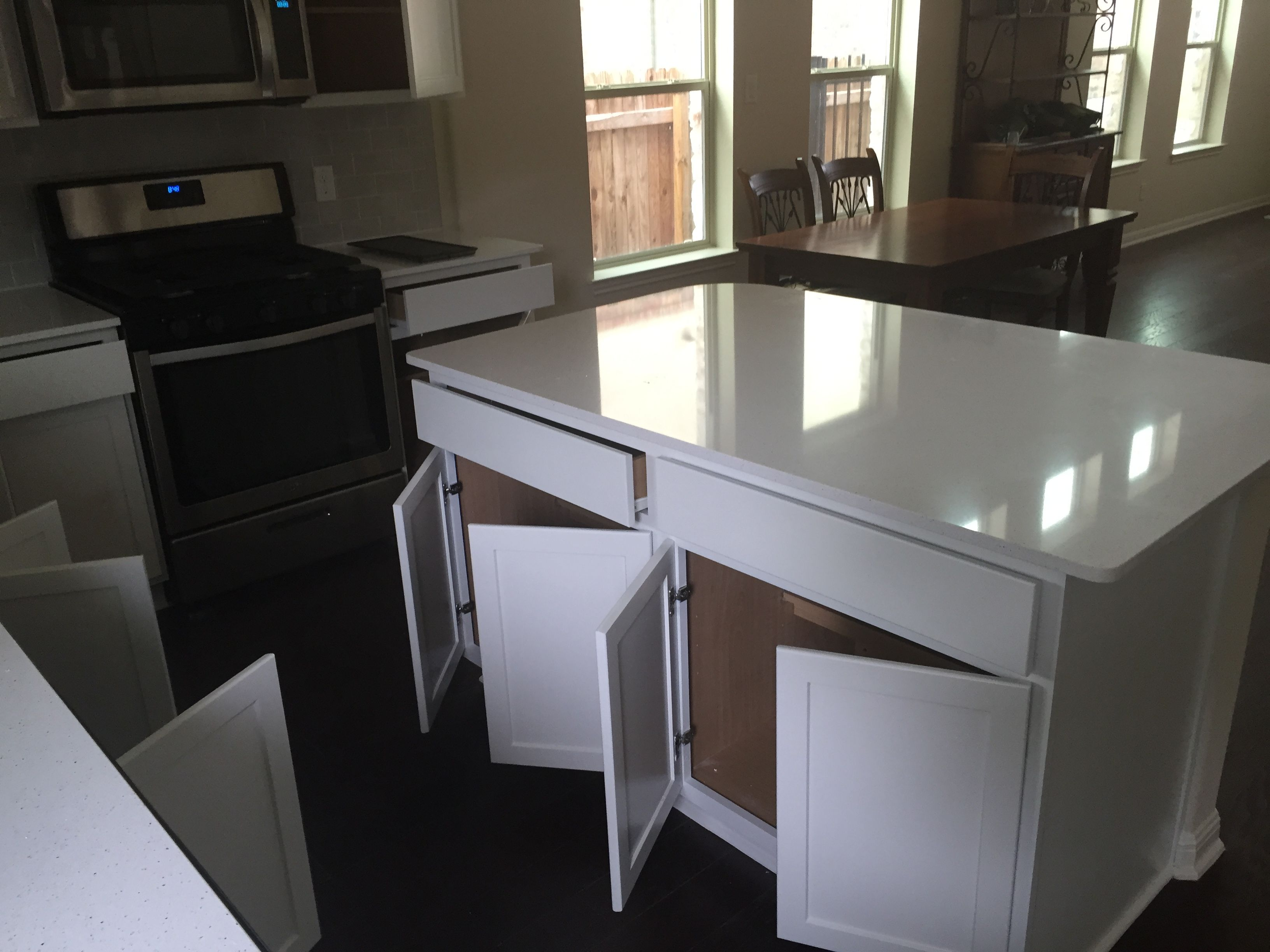 How To Brighten Up A Dark Kitchen Without Painting We Painted The Dark Kitchen Cabinets In This Cedar Park Home White To Help Brighten Up The Kitchen After White Kitchen Cabinets Dark Kitchen Kitchen Cabinets