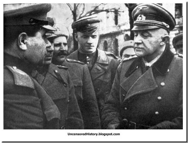 General Otto Lysh, the German officer in defence of Konigsberg after he signs the surrender on April 9, 1945.