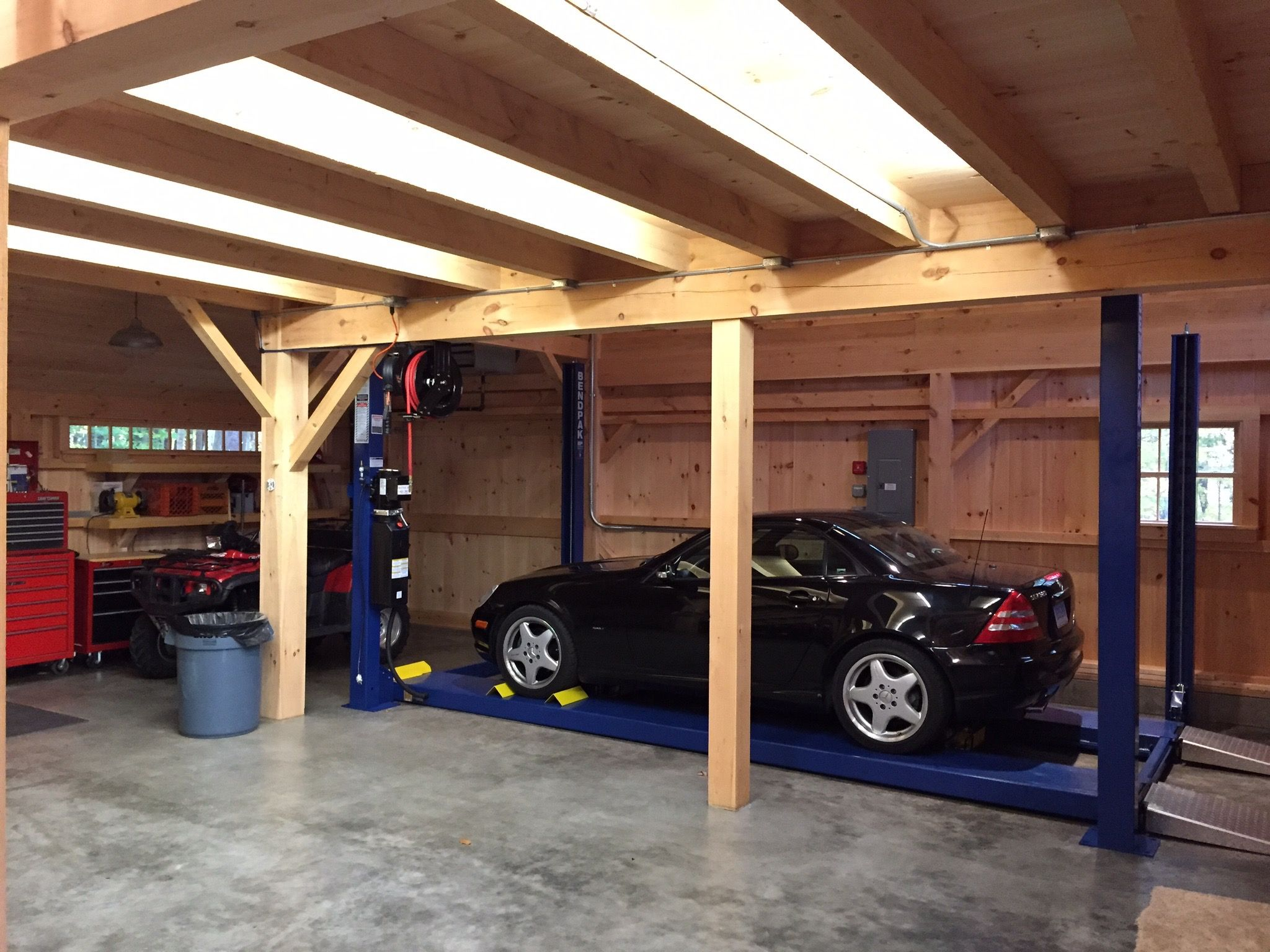 Car lift bay in our 1 1 2 story barn open to roof above for Car lift garage plans