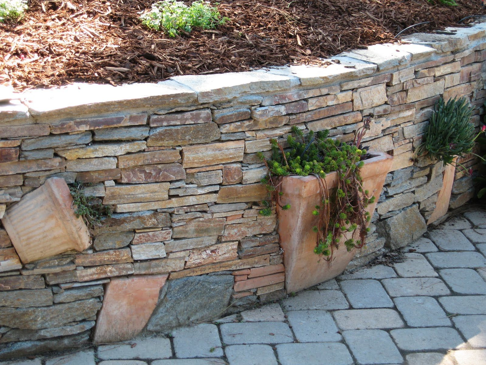 Planters Built Into The Stone Wall Gardening Backyard