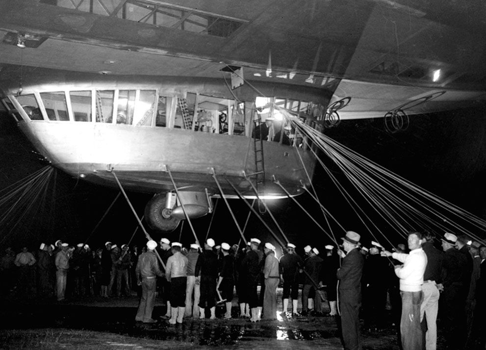 Spectators and ground crew surround the gondola of the Hindenburg as the lighter-than-air ship prepares to depart the U.S. Naval Station at Lakehurst, New Jersey, on May 11, 1936, on a return trip to Germany. (AP Photo) #