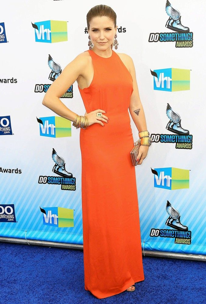 Sophia Bush attended at Do Something Awards on August 12th, 2012. Dress by Olcay Gulsen.
