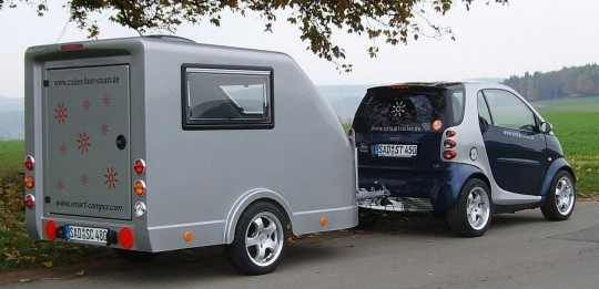 Smart Car Pulling A Camper