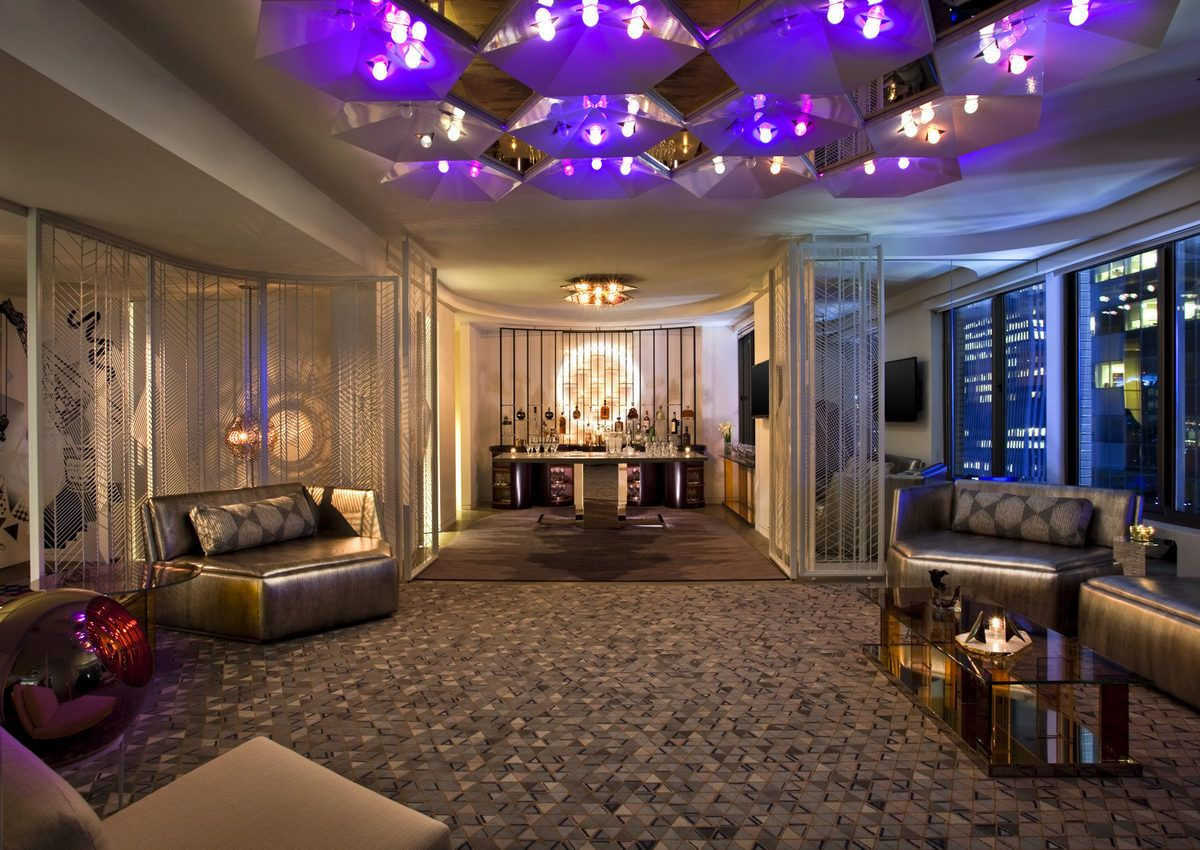 Nyc Penthouses For Parties This Nyc Penthouse Has Patterned Carpets A Gold Coffee Table