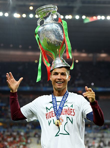 #EURO2016 Cristiano Ronaldo of Portugal holds the Henri Delaunay trophy to celebrate after his ...