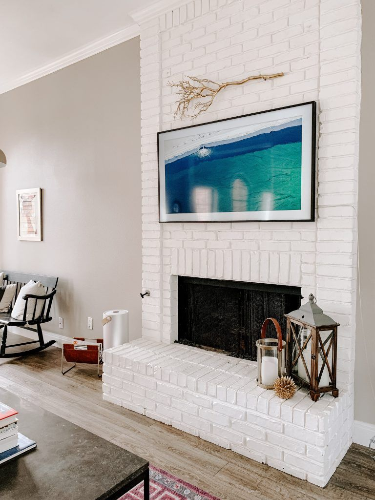 Updated painted brick fireplace #whitebrickfireplace