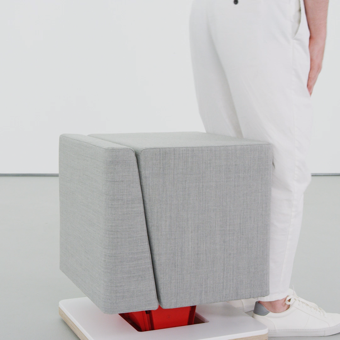 Responsive seat uses your gravitational energy to change from a minimal stool to a comfortable chair