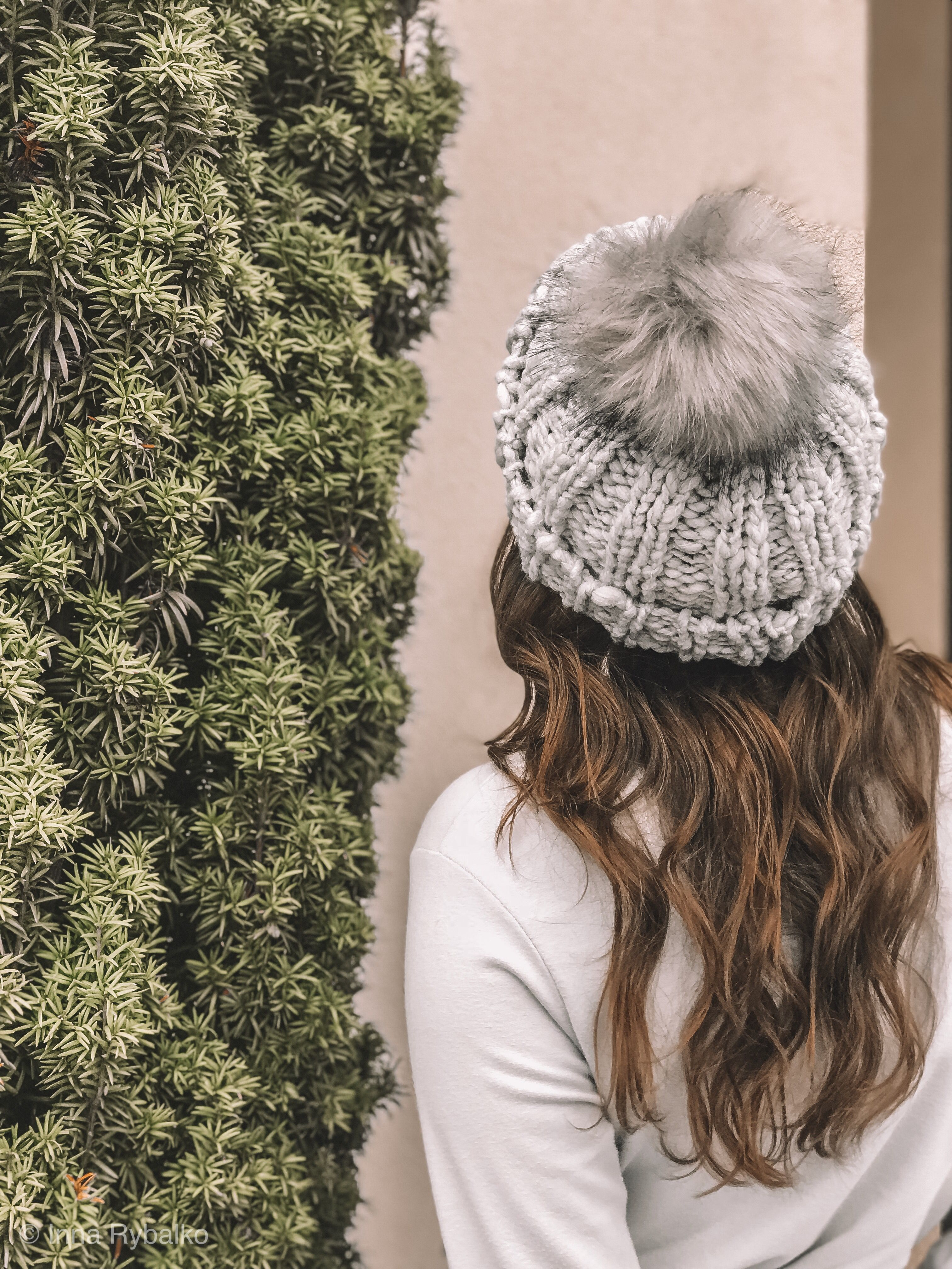 76bb9664e97 Thick light grey woven material beanie hat with a fuzzy Pom right on ...