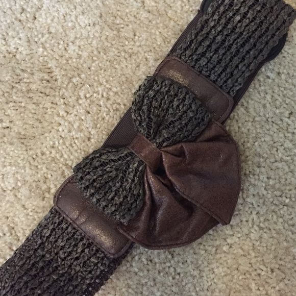 Bow Belt Brown broke out. Has  stretchy elastic and snaps for closure. Never worn Accessories Belts