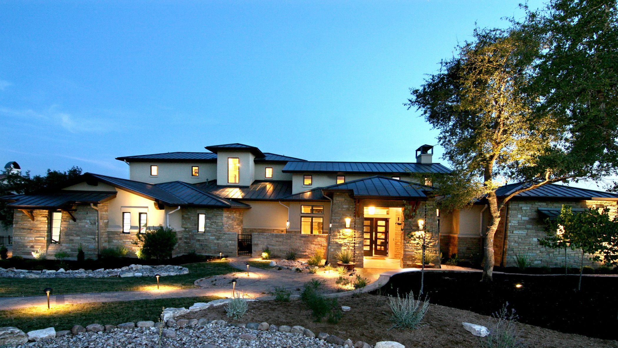 Hill country modern front elevation by zbranek holt for Texas custom home plans