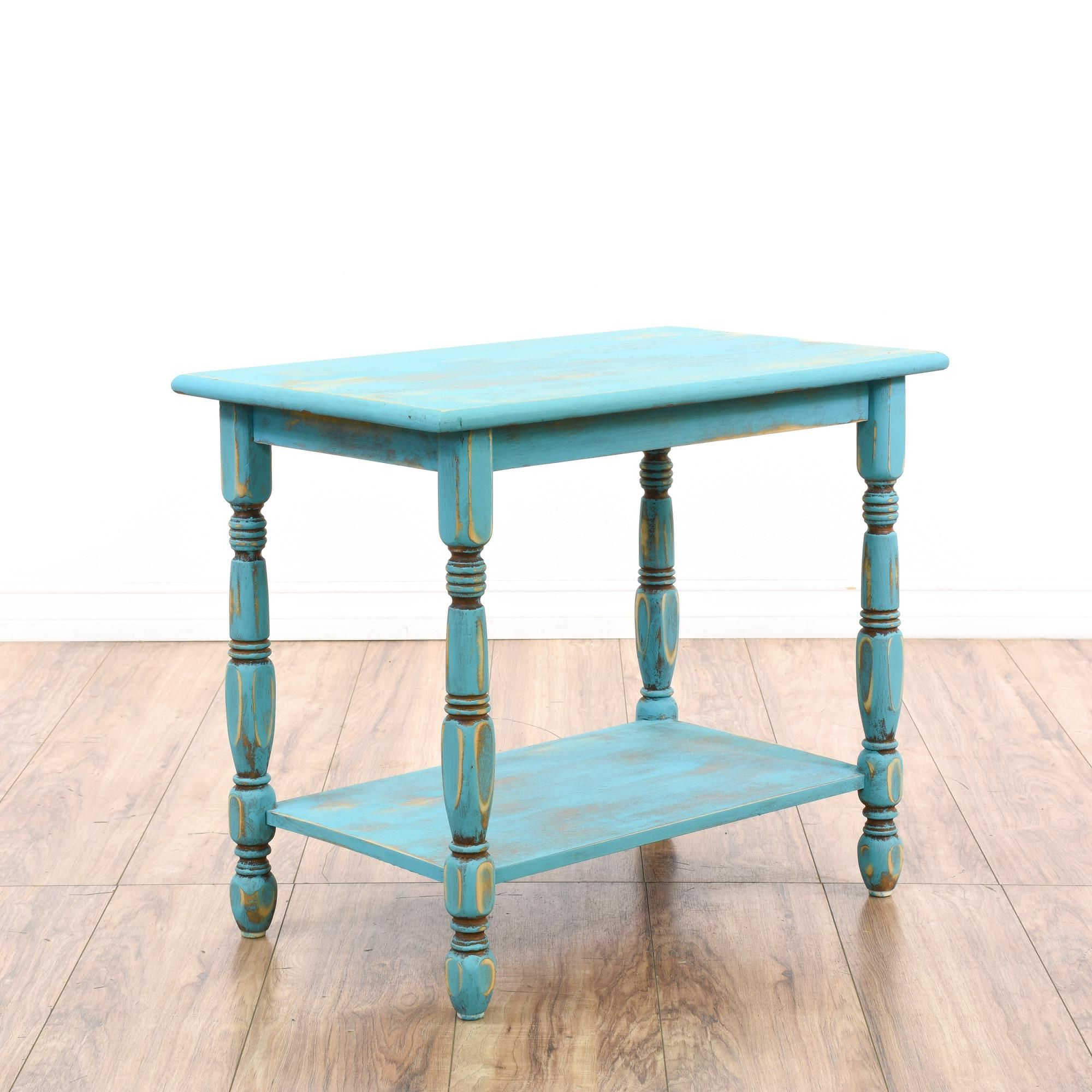 This shabby chic end table is featured in a solid wood with a