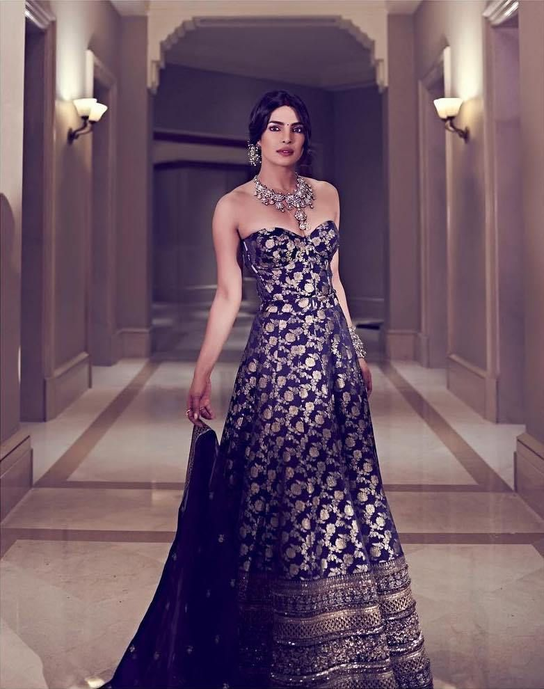 89d2f4cb811b Priyanka Chopra Nick Jonas s Mumbai Wedding Reception. Priyanka Chopra in  blue gold brocade Sabyasachi corset lehenga.  Frugal2Fab