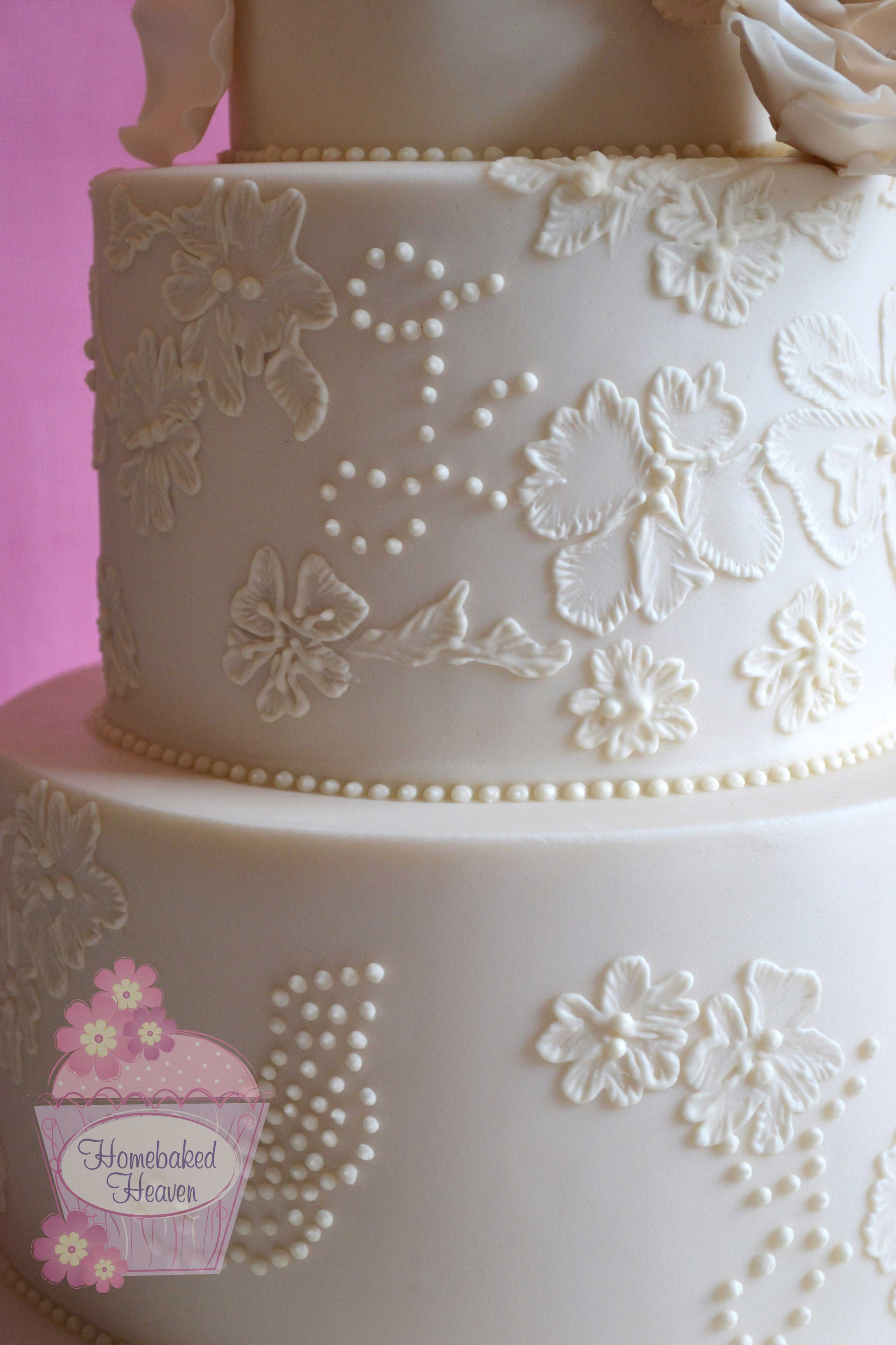 Close Up Detail Of Wedding Cake With Royal Icing Lace Brush