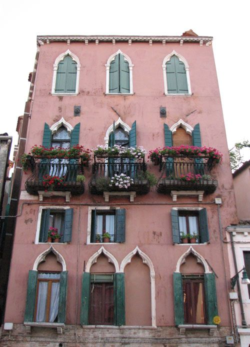 a typical old Ventian house with the 'three-leaves' windows,  along one of the canals