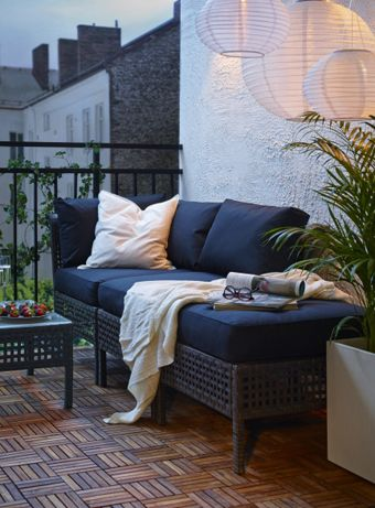 Brown KUNGSHOLMEN seat with grey cushions; RUNNEN Decking (acacia). Ikea.