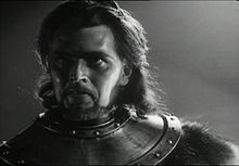 Lord Macduff, the Thane of Fife, is a character in William Shakespeare's Macbeth. Macduff plays a pivotal role in the play: he suspects Macbeth of regicide and eventually kills Macbeth in the final act. PIctured here is Dan O'Herlihy as Macduff in Orson Welles' controversial film adaptation of Macbeth from 1948.