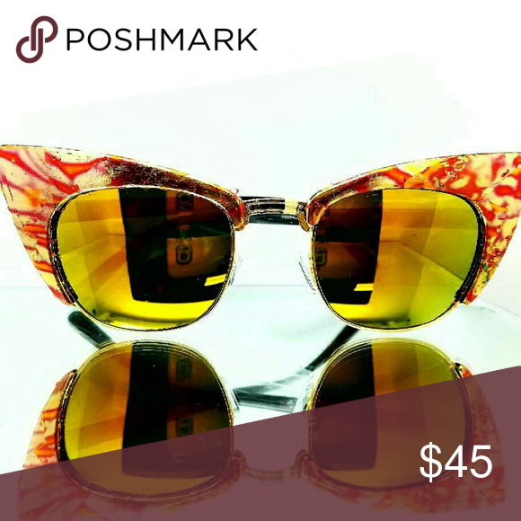 Custom designed sunglasses These sunglasses by were hand-crafted by designer Ritchie White. Its has a cool mirrored lens, and touched by some custom gold leafing. Ritchie White Accessories Sunglasses