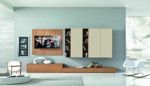 placards suspendus et un meuble de tv suspendu en bois, intérieur turquoise