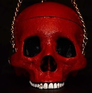 We make custom Skull Purses, Jewelry Boxes, SHOCK ART PRINTS, Branded Insanity T-Shirts, and custom madness! Check us out and get some cool stuff made for your Skull Fetish ;) www.skullasylum.com