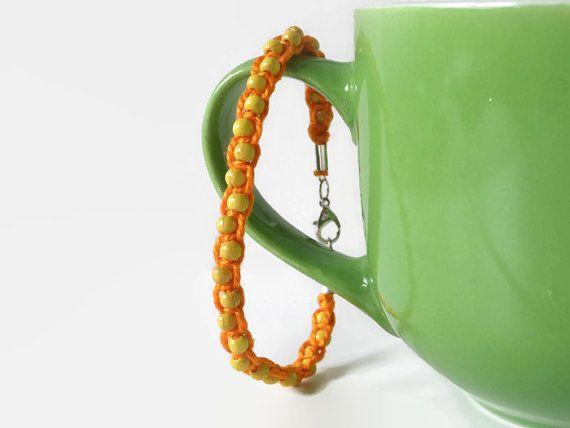 orange macrame hemp bracelet with yellow wooden beads ...