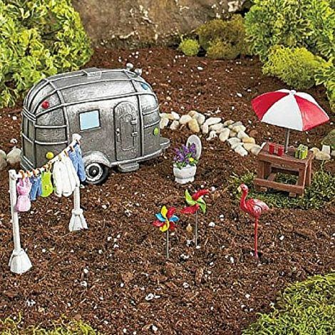 Weekend Camping Set www.teeliesfairygarden.com This experience fairies will get in this weekend camping set is what they've been longing for! They can enjoy refreshing drinks at the table, play with the pinwheels and travel in this adorable silver camper. #fairycamping