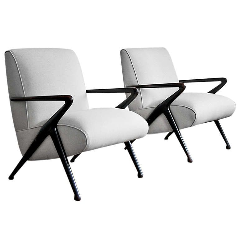 Pair of Italian Lounge Chairs | From a unique collection of antique and modern lounge chairs at https://www.1stdibs.com/furniture/seating/lounge-chairs/