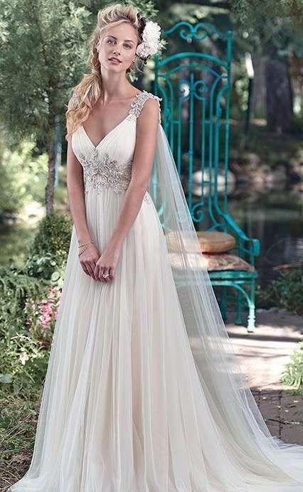 Vestido de novia con capas de tul
