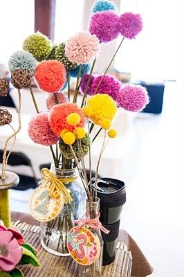 Pom Pom Flowers. Cute centerpiece on the cheap!
