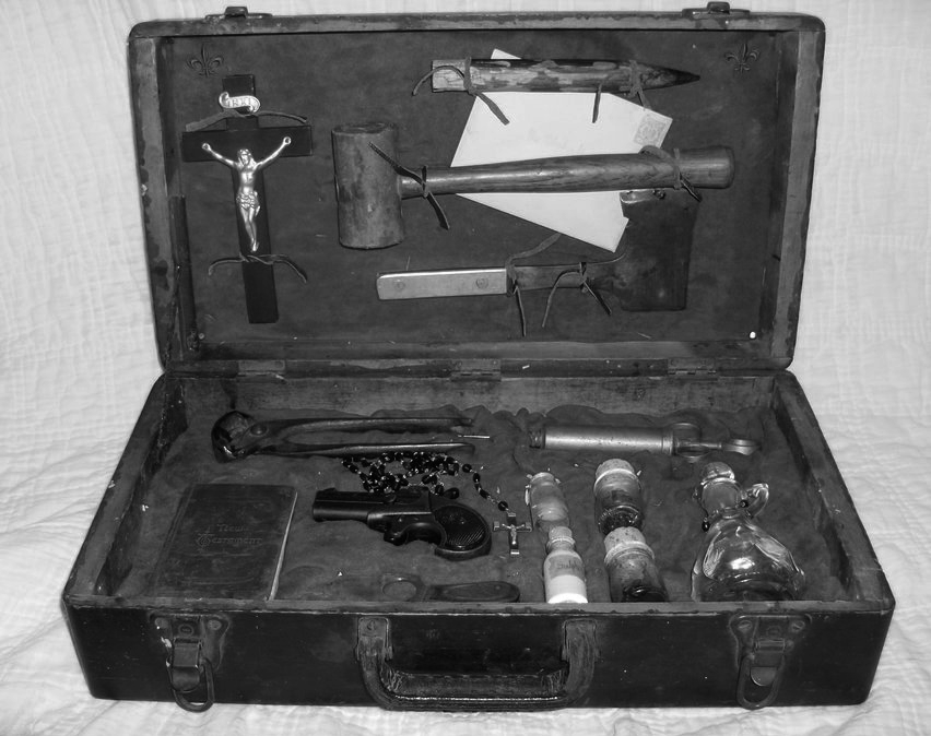 Vampire hunting kit from 1890.    Includes crucifix, stake, mallet, hatchet, German stamped letter to the mother of deceased victim, signed new testament bible by hunter Andrew Kauffman along with picture of victim, pliers, Remington derringer pistol, rosary, syringe, garlic extract, sulphur, hair from destroyed vampire, pulled fangs of destroyed vampire & holy oil.
