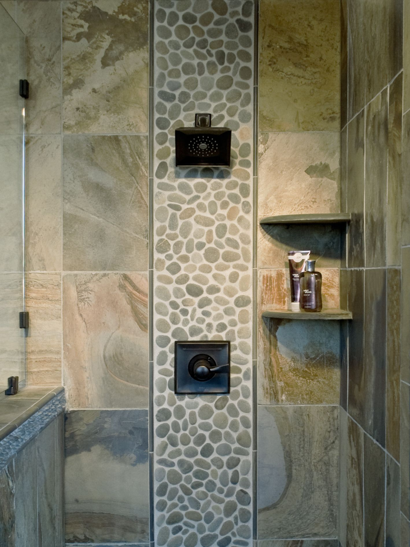Pebble mosaic tile in the shower. The tile