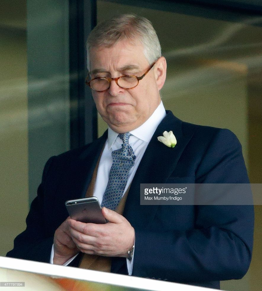 Prince Andrew, Duke of York uses his mobile phone as he attends day 4 of Royal Ascot at Ascot Racecourse on June 19, 2015 in Ascot, England.