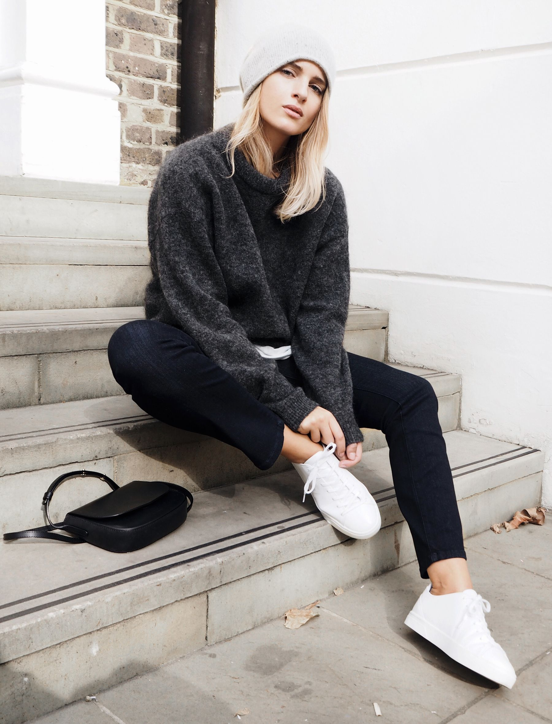 dd875eb0f0b Mirjam Flatau wears a gorgeous knit sweater with black jeans and sneakers.  Jumper  Acne Studios