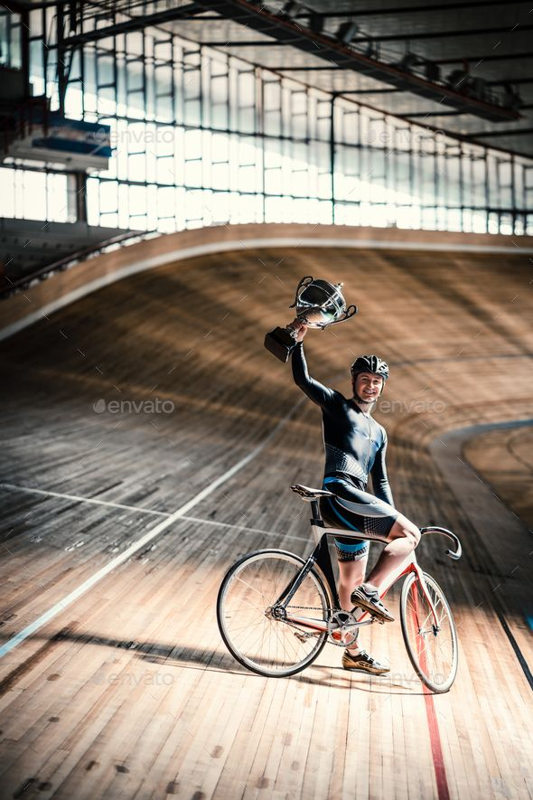 Athlete On Velodrome By Aboutimages Happy Sportsman With A