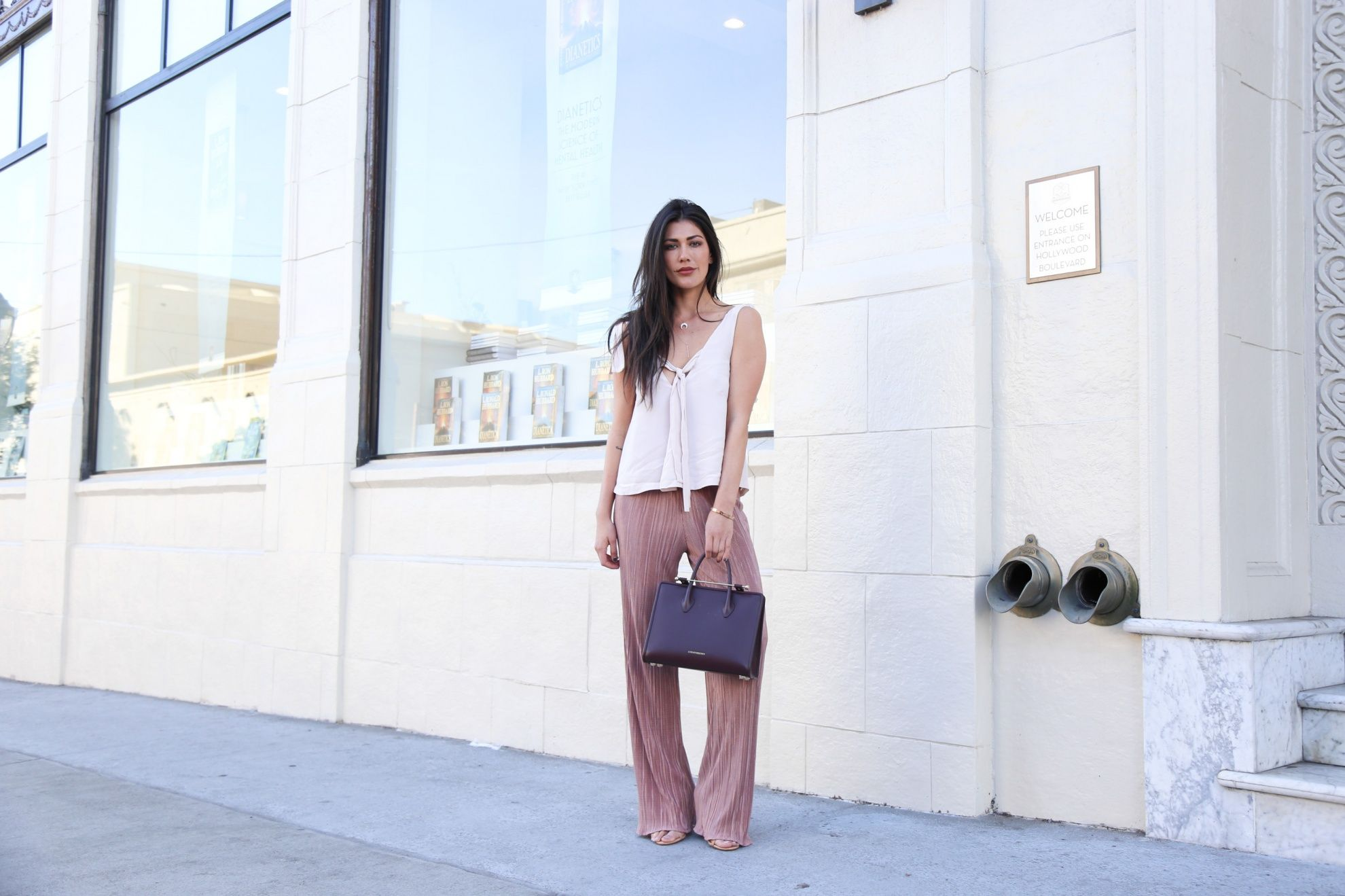2181cb0f4fe6 Sara Montazami carries The Strathberry Midi Tote in Burgundy