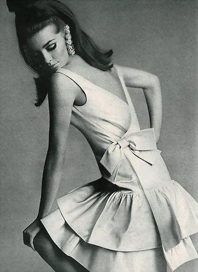 Astrid Heeren is wearing a white satin flounced dress from a Vogue Pattern.  photo by Bert Stern for Vogue 1960