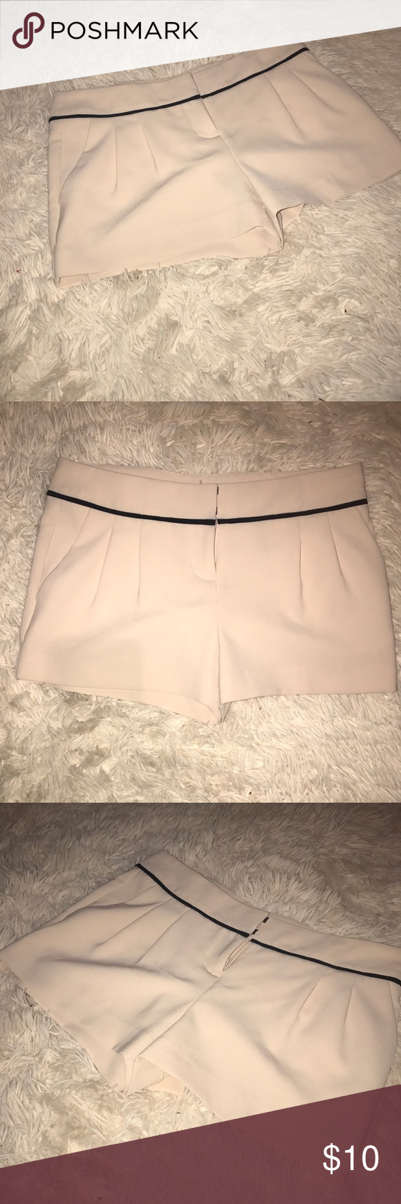 Cream Shorts Cream shorts. Great quality material. They say they're a size 00 but it definitely runs big. Could fit a size small. *never worn* Express Shorts