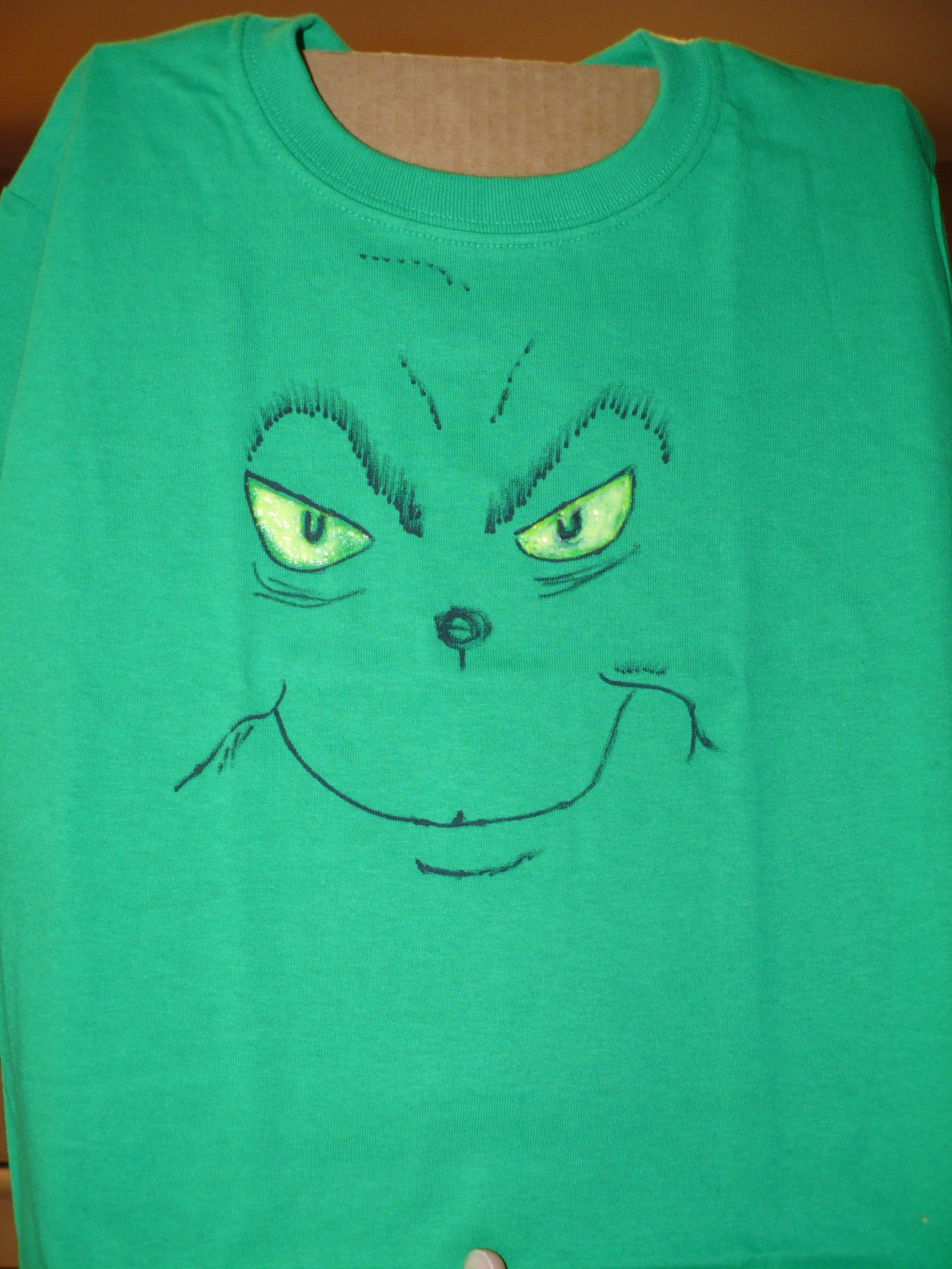 bd6b3d48 Made grinch face t-shirts for my kids for Dr. Seuss day. Green t-shirt,  neon yellow glow in the dark puffy paint, and black fabric paint marker.