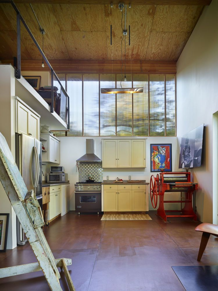 Kitchen With Salvaged Cabinets In Small House: Olson Kundig Architects