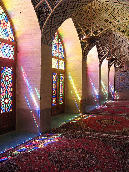 The stained glass creates such a wonderful spectrum of color as the sun pours through the window.