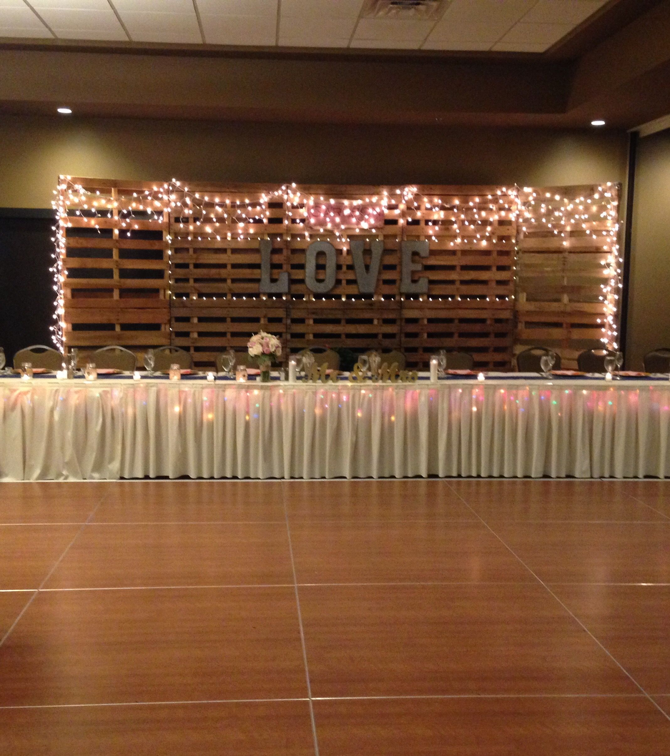 Wedding Reception Head Table Ideas: Rustic Backdrop For The Head Table. #bigBRUKENdeal