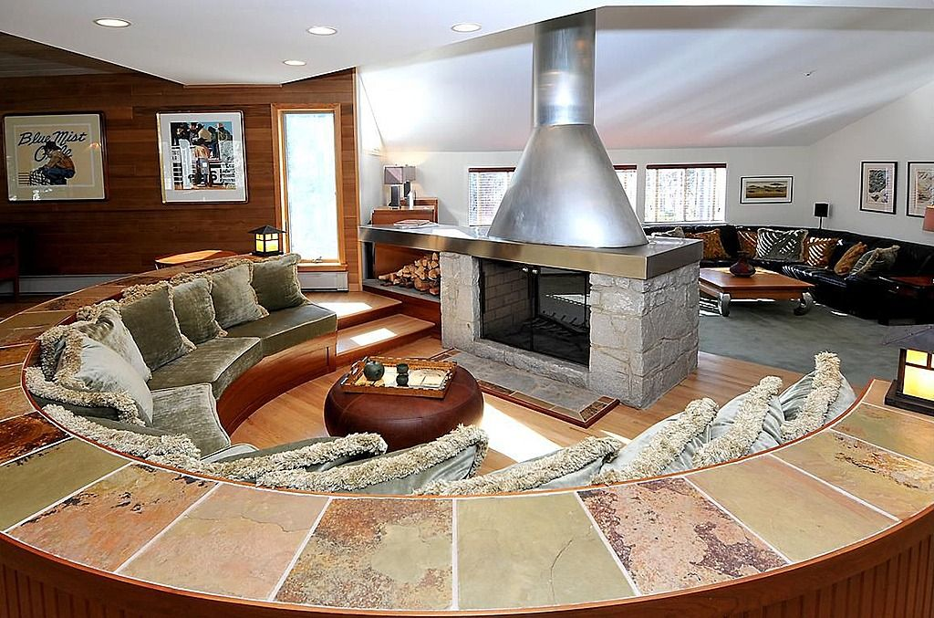 Gather 'round the fireplace with room for friends and ... on Living Room Fire Pit id=97836