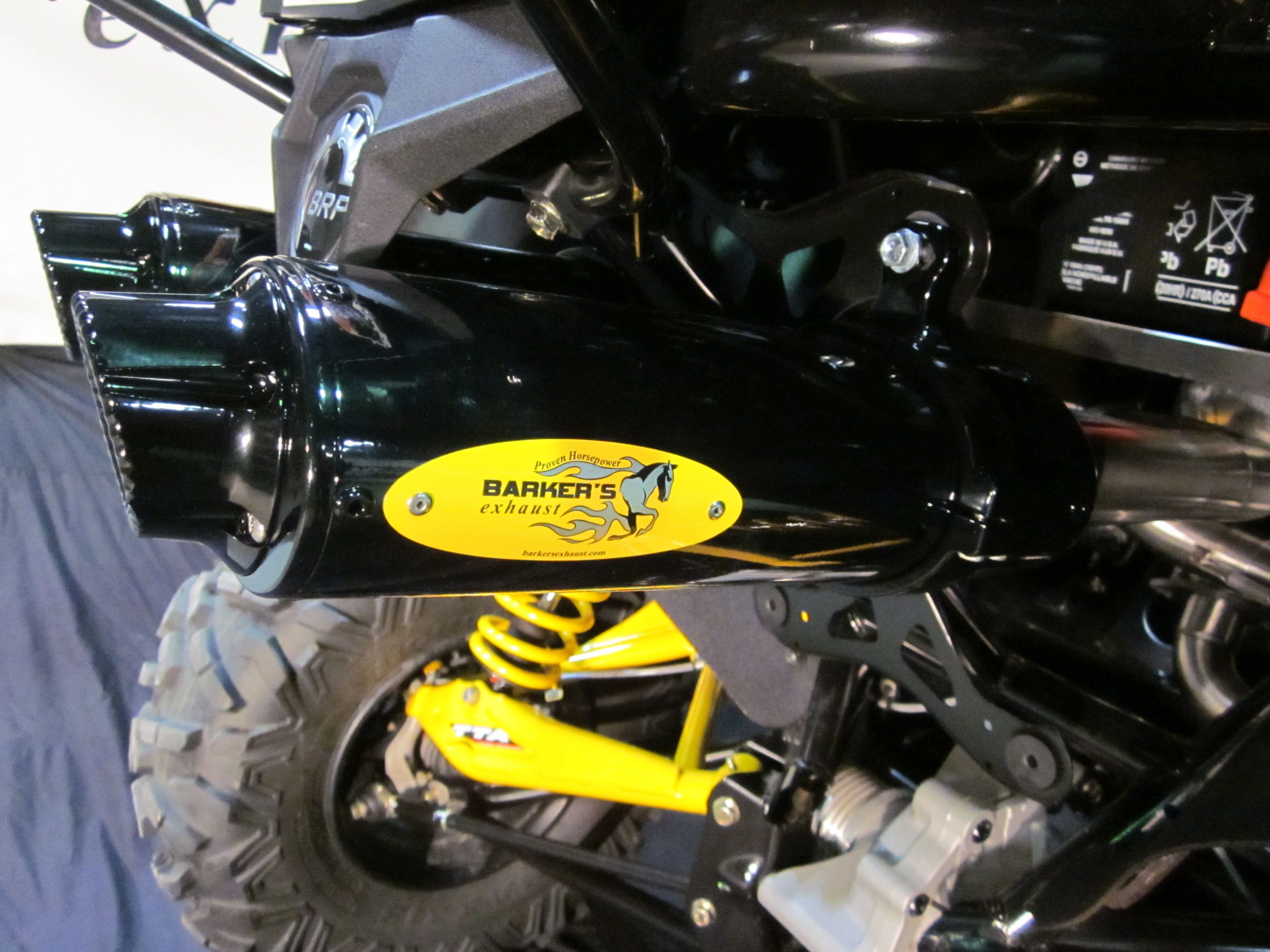 Barkers custom exhaust system on a can am maverick can tip shown in black