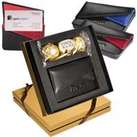 Ferrero Rocher® Chocolates & Card Case Gift Set  Includes the LG-9187 Fairview Business Card Case and a 3-pack of Ferrero Rocher® Hazelnut Chocolates Card case is made from cowhide leather with ballistic nylon trim and 210d nylon interior with dual-flap magnetic closure, front pocket and main pocket     Product code: LG-9231  Qty:	25-149	150-299	300-599	600-2499	2500+  ea.	$17.00	$16.50	$15.50	$13.95