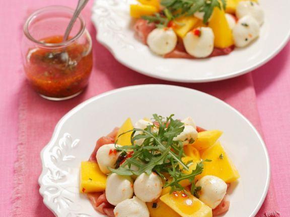 Salat mit Mango, Schinken und Mozzarella ist ein Rezept mit frischen Zutaten aus der Kategorie Dressing. Probieren Sie dieses und weitere Rezepte von EAT SMARTER!