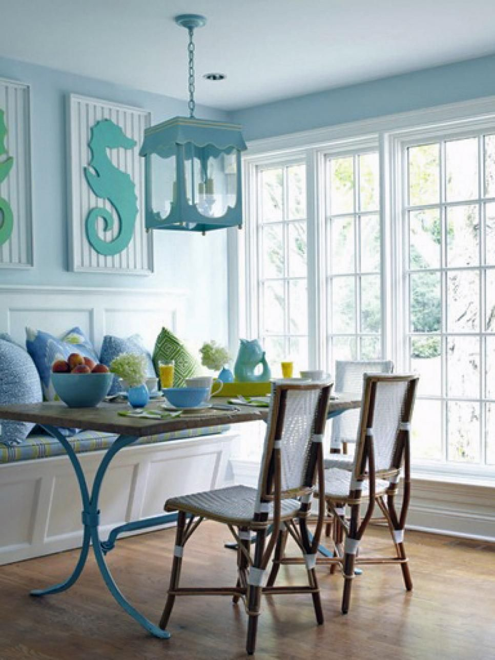 Blue coastal dining area with cute wall