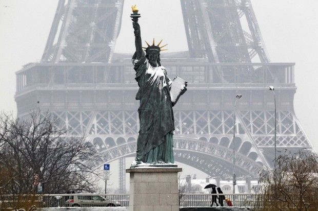 Paris S Statue Of Liberty Stands With A Dusting Snow Near The Eiffel Tower In Picture Reuters Mal Langsdon